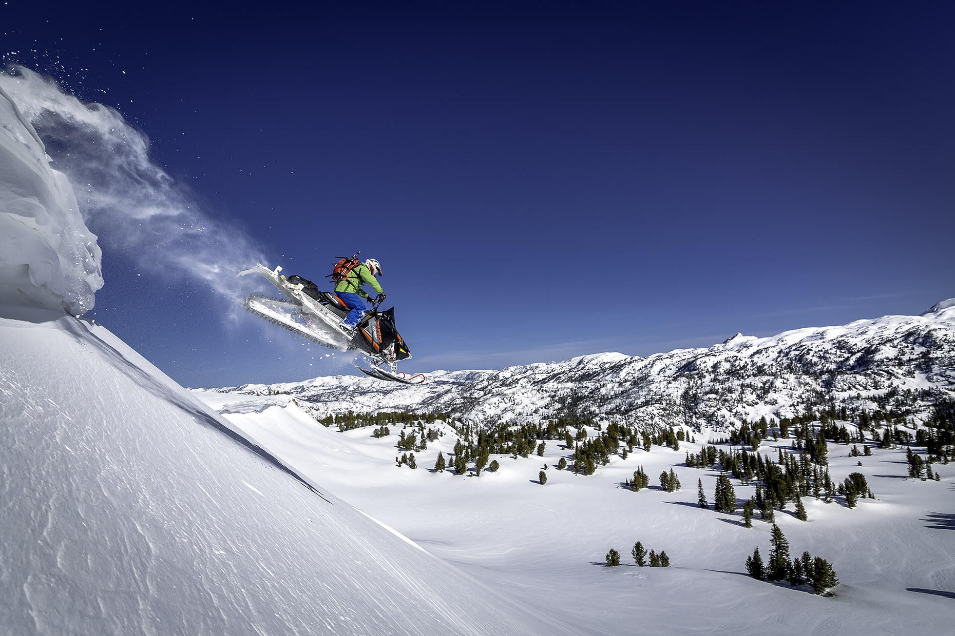 DAP sport snowmobile CJ Cooke City powder jump